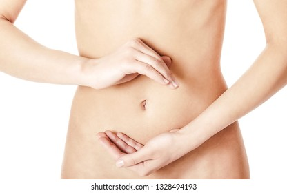 Women abdomen with hands making circle on white background.