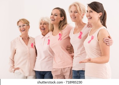 Women of all ages united with the pink ribbon of breast cancer awareness
