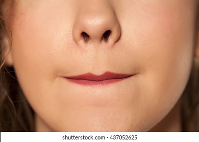 women allocated lipstick with her lips