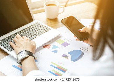 Women analyze graphs and charts financial profits from business