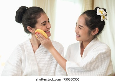 The women applied the cream on face.