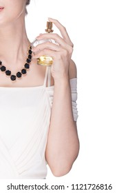 Women applying perfume on her wrist.