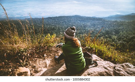 women asians travel relax in the holiday. Admire the atmosphere landscape on the Moutain. Mountain Park happily. In Thailand