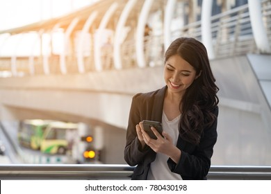 Women are Attractive Age 20-30 years old hold phone business woman Shopping online through a smart phone  After fans approve credit limit to spend the Holiday ,concepts technology and online trading,