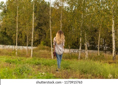 Women in the autumn forest