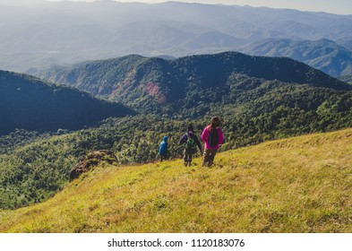 Women with backpack hiking on mountains