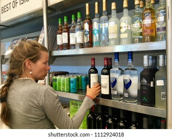 Women bays wines in Duty free shop at the airport ben-gurion Israel. Israel,Tel Aviv, June 2018