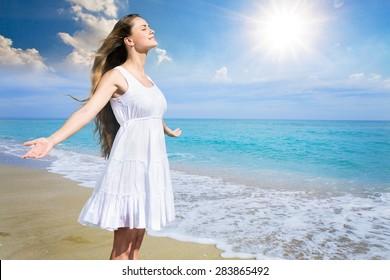 Women, beach, sunset.