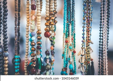Women beads and necklace in jewerly market. Bali island.