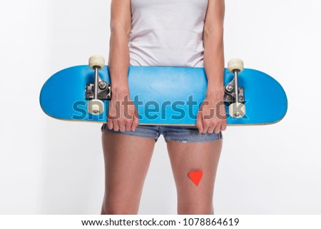 c3acb258 Women with beautiful legs wearing jeans shorts, close up on thighs with red  paper stickers