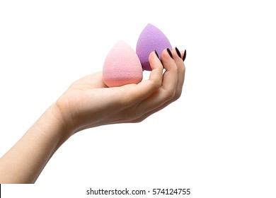 Women with  beauty blender on a white background