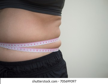 women with belly fat.