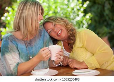 women, best close friends laughing