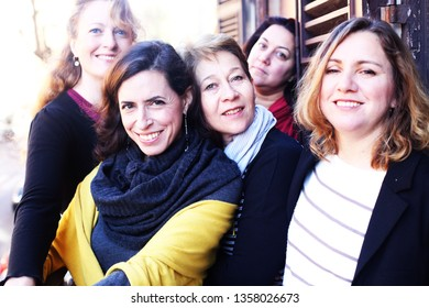 Women best friends smiling, drinking morning coffee