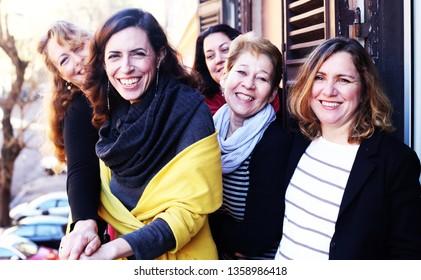 Women best friends smiling, drinking morning coffee