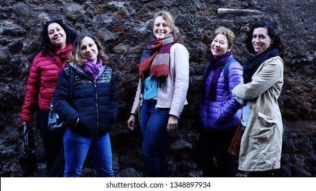 Women best friends smiling and walking at the city