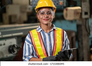 Women black professional factory engineer, worker, Quality control, maintenance, business factory industry warehouse Workshop operators, engineering black women. Portrait female happy smiling factory.