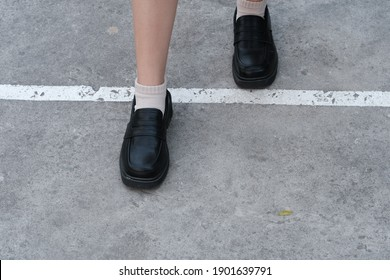 Women and black shoes on the street
