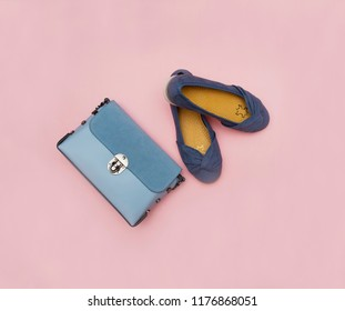 Women blue bag and shoes isolated on the pink background