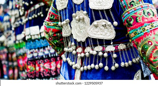 Women in blue traditional festival clothes and silver accessories for ceremony start at Miao village in Guizhou, China