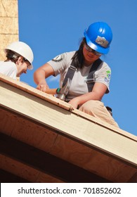 Women build roof for home for Habitat For Humanity For Humanity. El Rincon, Oakland, Calif on Jan 22, 2011