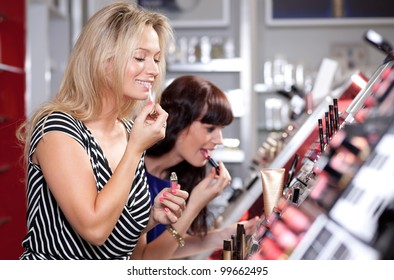 Women buying and testing cosmetics in a beauty store