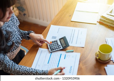 Women are calculating about her expenses and liabilities. Female businessmen are calculating taxes from the profits of the company. Creditors are calculating and writing invoices to their debtors.