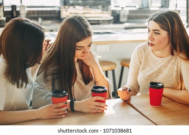 Women calming their upset friend. Two women comforting crying girl. Friendship, help, support, care, attention