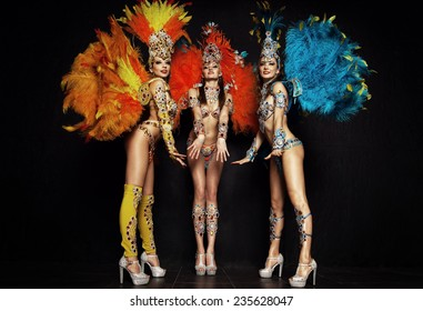Women in carnival dresses