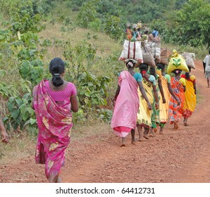 Women carry goods on their heads for weekly market  in Orissa, India