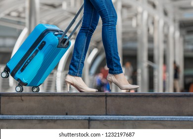 Women carry on travelling suitcase or bag, get ready for travel.