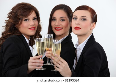Women celebrating with a glass of wine