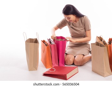 women check shopping bags  after clearance sale