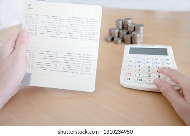 Women checking amount in bank account passbook