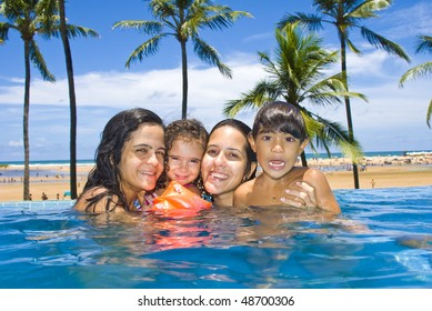 Women with a children in the pool .