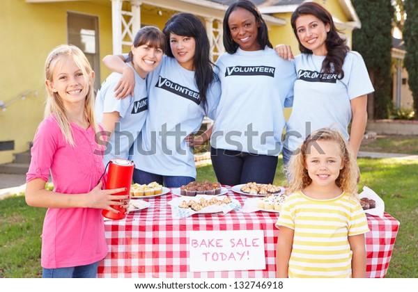 Women And Children Running Charity Bake Sale