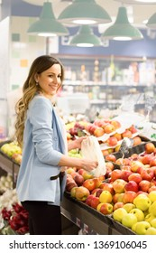 Women choosing a dairy products at supermarket. Reading product information