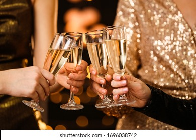 Women clinking glasses of tasty champagne at party