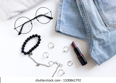 Women clothes, cosmetics and accessories on a white background