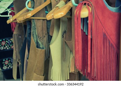 women clothes hanging on a rack clothes store, vintage tone photo