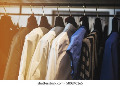 Women clothes on racks in a boutique store