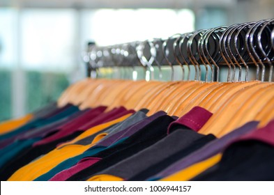 women clothing is hanged on the rack.
