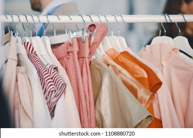 Women clothing on hangers in a boutique store