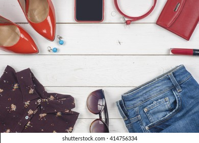 Women clothing set and accessories on a rustic wooden background.Top view,  different shoes on  light wooden background.  Copy space for text.