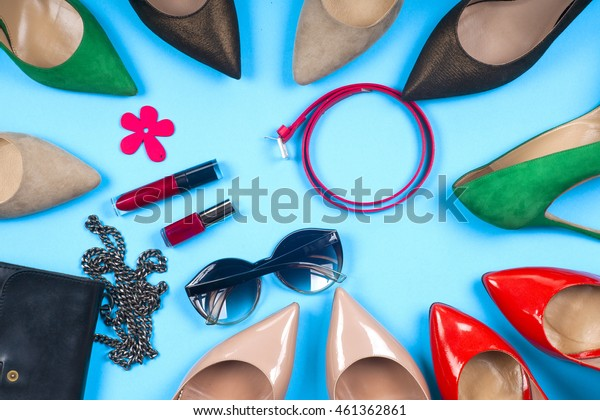 Women clothing set and accessories on light background.Top view, different shoes on light background. Copy space for text.