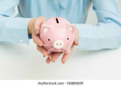 Women are collecting money in a piggy bank.