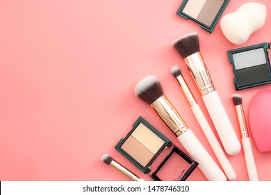 Women cosmetics and fashion, makeup artist kit and applying face blush concept theme with blusher application brush set, facial powder and blending sponge isolated on pink background with copy space