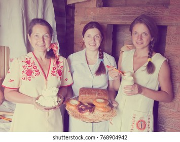 Women with country home-made meal in rural house interior