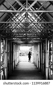 Women crossing overpass in black&white,beautiful architecture