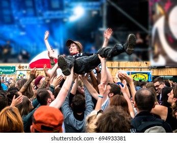 Women crowd jumping in Woodstock Festival, blurred background, Poland. 6 August 2017. Huge free summer music festival held the beginning of August in Kostrzyn and Odra, massive free music and arts.